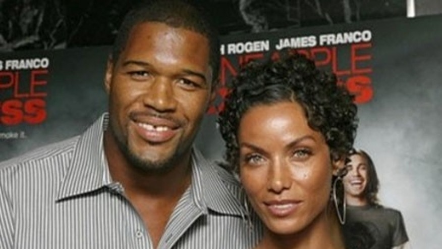 Strahan with girlfriend Nicole Murphy, on whom he keeps a VERY close eye.