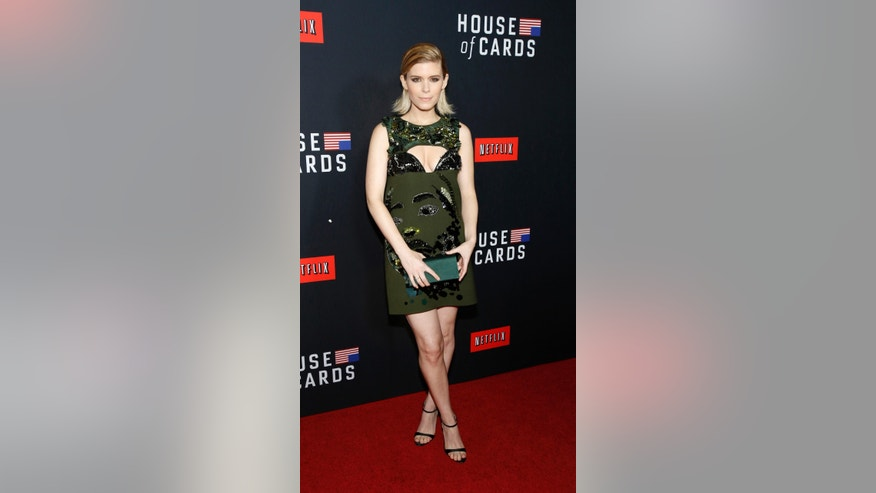 "Cast member Kate Mara poses at the premiere for the second season of the television series ""House of Cards"" at the Directors Guild of America in Los Angeles, California February 13, 2014. Season 2 premieres on Netflix on February 14.   REUTERS/Mario Anzuoni  (UNITED STATES - Tags: ENTERTAINMENT) - RTX18SH9"