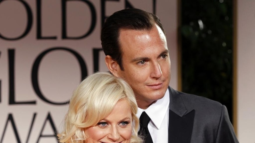 FILE - This Jan. 15, 2012 file photo shows actors Amy Poehler, left, and Will Arnett arriving at the 69th Annual Golden Globe Awards in Los Angeles. Arnett filed for divorce from Poehler on April 8, 2014, in Los Angeles Superior Court more than 18 months after the pair announced they were separating and ending their nine-year marriage. (AP Photo/Matt Sayles, file)