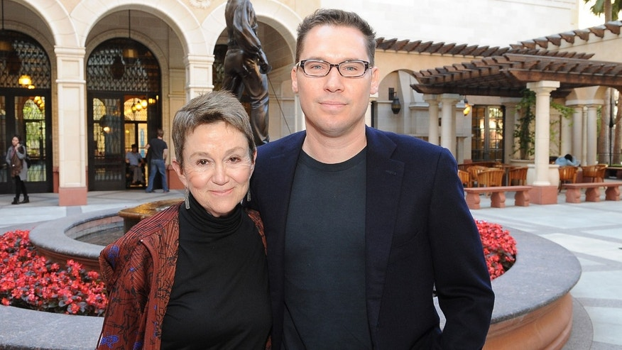 Octobre 14, 2013: University of Southern California School of Cinematic Arts Dean Elizabeth Daley and director Bryan Singer after the school renamed its Critical Studies Division after the director