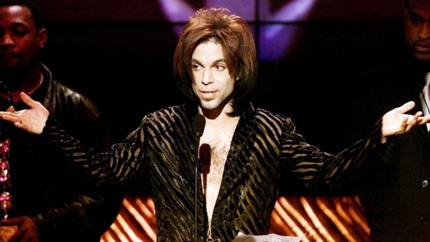 """The Artist"" formerly known as Prince gives his acceptance speech after being named Male Artist of the Decade at the 14th annual Soul Train Music Awards March 4. - RTXJKPE"