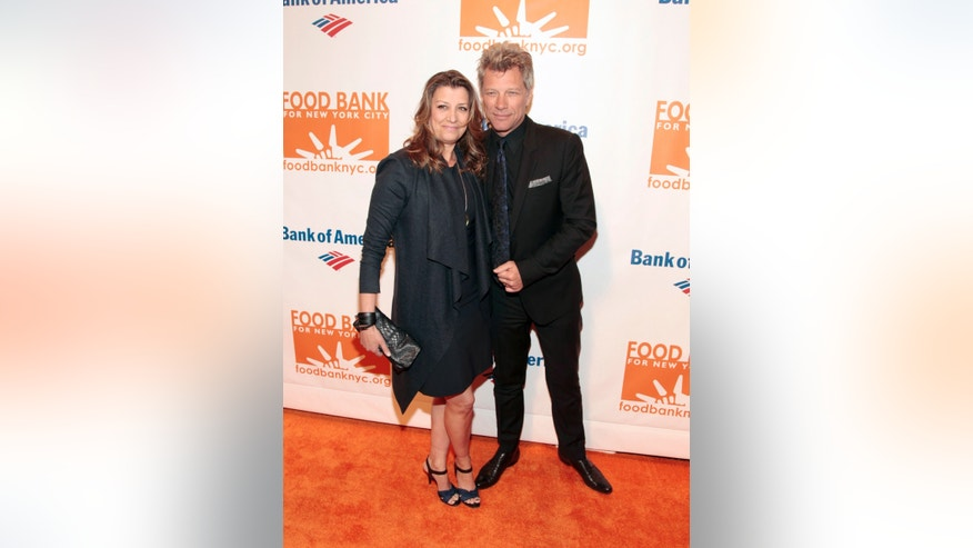 April 9, 2014. Recording artist Jon Bon Jovi, right, with his wife Dorothea Hurley, attends the Food Bank of NYC Can Do Awards Benefit Gala in New York.