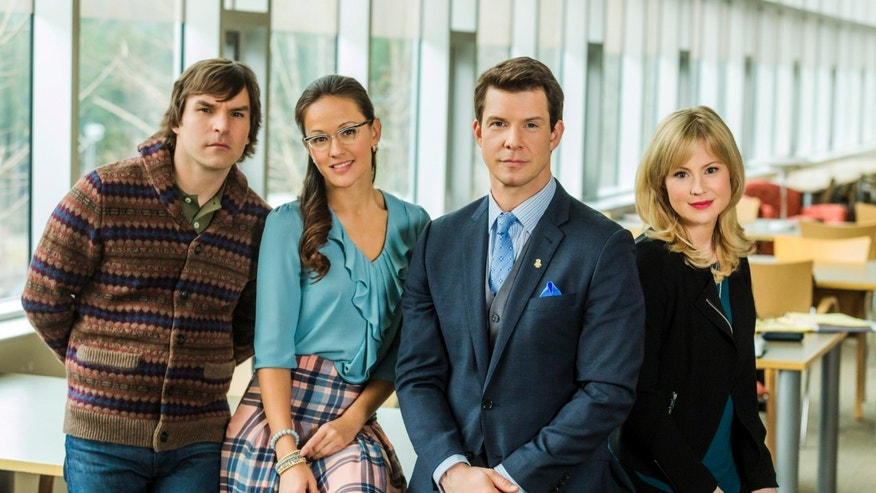 "Geoff Gustafson (Norman Dorman), Crystal Lowe (Rita Haywith), Eric Mabius (Oliver OToole) and Kristin Booth (Shane McInerny), on the set of the TV series, ""Signed, Sealed, Delivered.""  The writer-producer Martha Williamson, who produced Touched by an Angel, returns to TV with the new Hallmark Channel show, debuting Sunday, April 20, 2014."