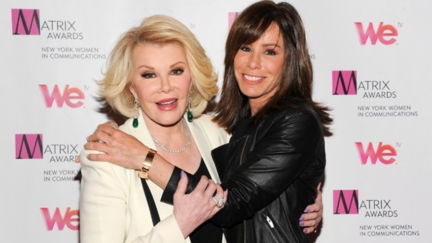 April 22, 2013: Television personalities Joan Rivers, left, and daughter Melissa Rivers attend the 2013 Matrix New York Women in Communications Awards at the Waldorf-Astoria Hotel, in New York.