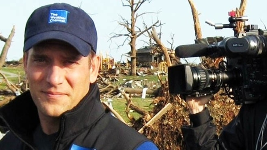 "This 2011 image released by the Weather Channel shows meteorologist Mike Bettes at the scene of a tornado in Joplin, Mo. Bettes will hit the road starting Monday for ""Tornado Week,"" his network's version of ""Shark Week"" thats usually its biggest scheduled programming event of the year. ""Tornado Week"" will include a special about chasers caught up in the tornado in El Reno, Okla. A new series, ""Tornado Alley,"" will premiere with storm footage, survivor tales and computer graphics to simulate actions of certain tornadoes. (AP Photo/Weather Channel)"