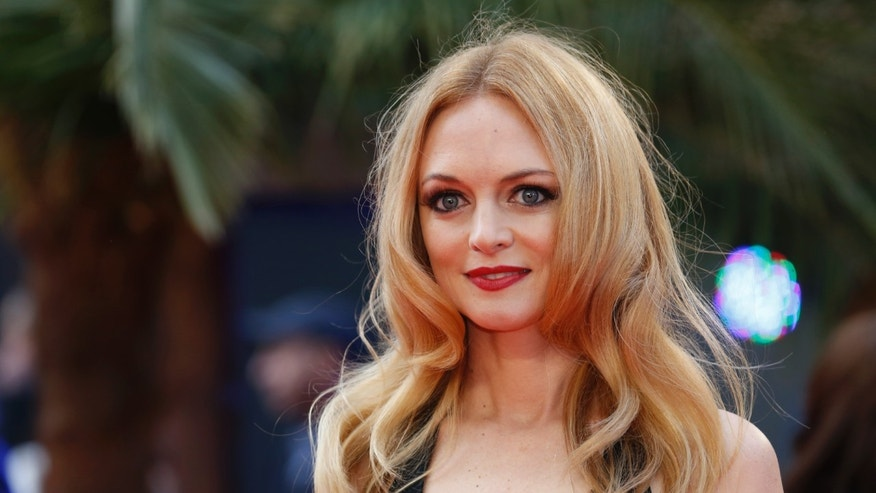 Heather Graham arrives for the European premiere of the film The Hangover Part III at the Empire Cinema in central London May 22, 2013. REUTERS/Luke MacGregor  (BRITAIN - Tags: ENTERTAINMENT) - RTXZWVZ