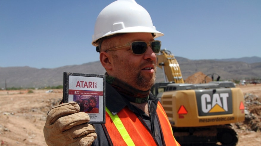 "April 26, 2014. Film Director Zak Penn shows a box of a decades-old Atari ""E.T. the Extra-Terrestrial"" game found in a dumpsite in Alamogordo, N.M."
