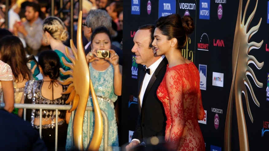 April 26, 2014. Kevin Spacey poses with Deepika Padukone on the green carpet at Raymond James stadium for the 15th International Indian Film Academy Awards in Tampa, Fla.