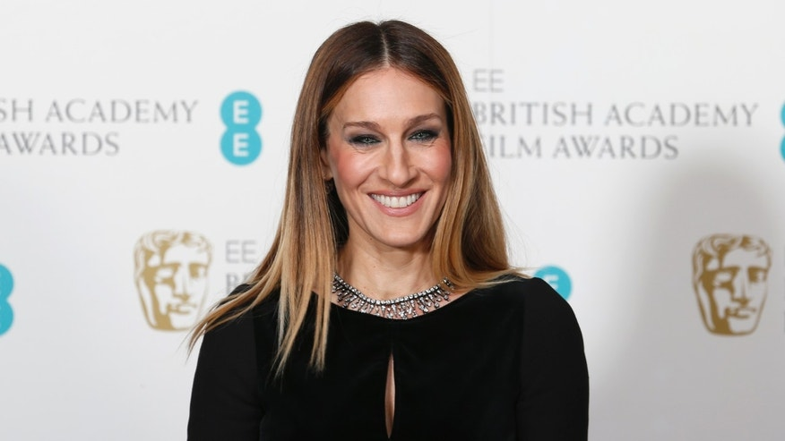 February 10, 2013. Sarah Jessica Parker poses for photographers at the British Academy of Film and Arts (BAFTA) awards ceremony at the Royal Opera House in London.
