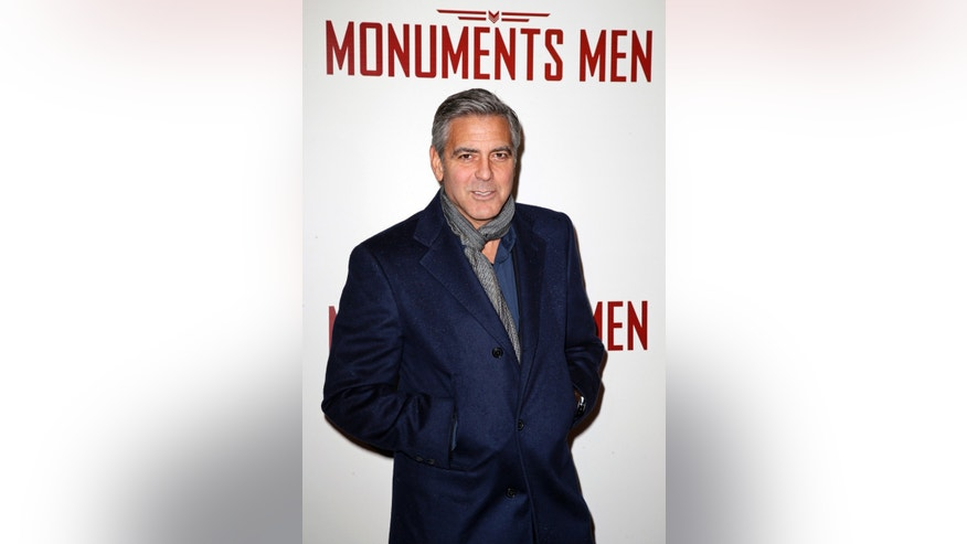 "February 12, 2014. Actor George Clooney arrives arrives for the French premiere of the film ""The Monuments Men"" in Paris."