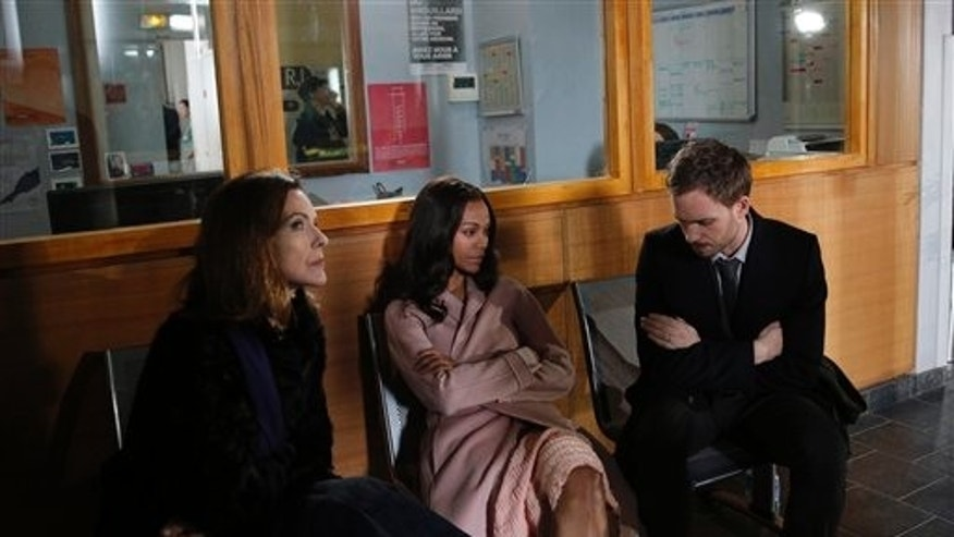 Actors Zoe Saldana, center, Patrick J. Adams and French actress Carole Bouquet sit during the shooting of the adaptation of the psychological horror movie Rosemarys Baby by Polish director Agnieszka Holland in Issy-les-Moulineaux, outside Paris, Friday March 7, 2014. Saldana is Rosemary Woodhouse in the two-episode remake of Ira Levins 1967 book, which director Roman Polanski also turned into an unforgettable 1968 film. The four-hour series directed by Agnieszka Holland also stars Patrick J. Adams, Jason Isaacs and Carole Bouquet. (AP Photo/Christophe Ena)