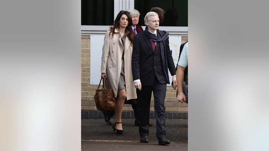 In this Thursday, Nov 24, 2011 file photo, lawyer Amal Alamuddin, left, is seen walking alongside WikiLeaks founder Julian Assange as they leave Belmarsh Magistrates Court in south east London after his extradition hearing to Sweden to be prosecuted over claims of sexual assault.