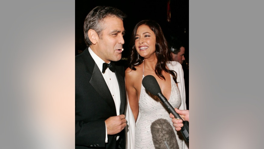 "FILE - In this Dec. 8, 2004 file photo, cast member George Clooney, left, speaks to the media with British actress Lisa Snowdon as they arrive for the premiere of ""Ocean's Twelve,"" at the Grauman's Chinese Theatre in the Hollywood section, of Los Angeles. Clooney, 52, Hollywood's most determined bachelor, famous for a litany of fleeting loves, including Snowdon, has taken himself off the romantic market and proposed to 36-year-old attorney Amal Alamuddin. A spokesman for the Oscar-winning actor and producer did not respond to requests for comment Monday, April 28, 2014. (AP Photo/Kevork Djansezian, file)"