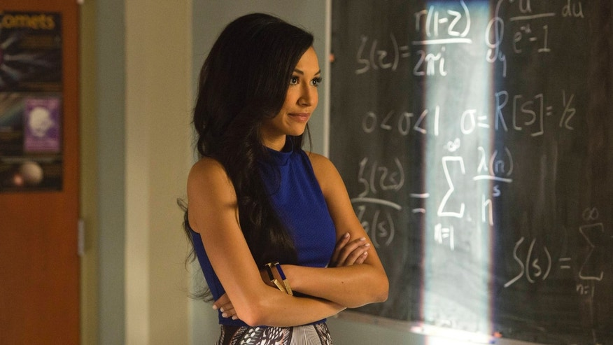 Santana (Naya Rivera) returns to McKinley High in the 100th episode of Glee.