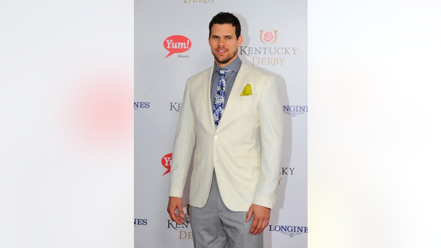 Kris Humphries is photographed at the 140th Kentucky Derby Saturday, May 3, 2014 in Louisville Ky. (Photo by Joe Imel/Invision/AP)