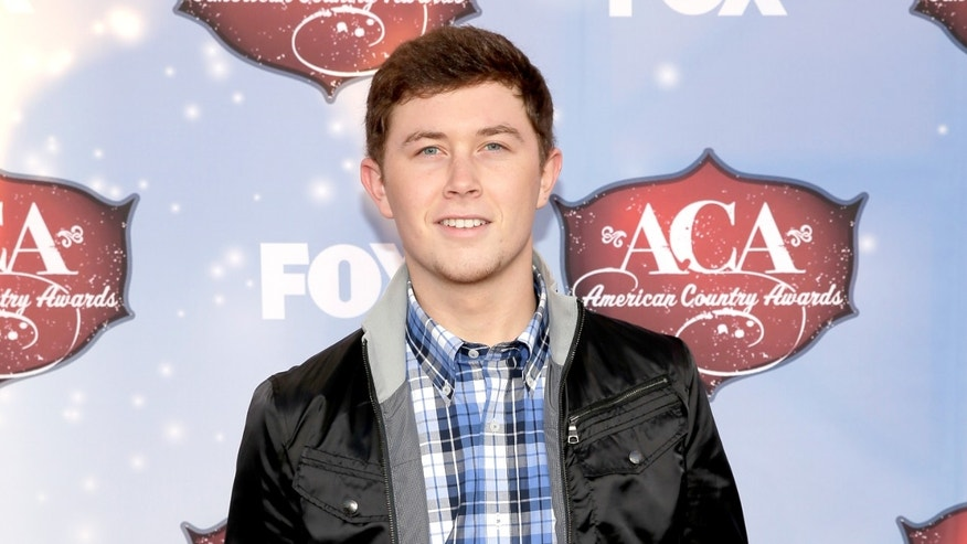 LAS VEGAS, NV - DECEMBER 10:  Recording artist Scotty McCreery arrives at the American Country Awards 2013 at the Mandalay Bay Events Center on December 10, 2013 in Las Vegas, Nevada.  (Photo by Isaac Brekken/Getty Images)