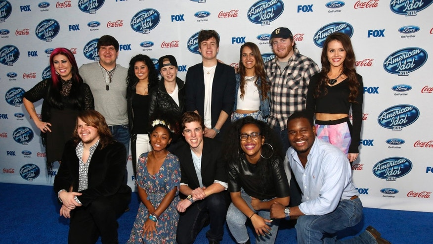 "Finalists (from L-R standing) Jessica Meuse, Dexter Roberts, Jena Irene, MK Nobilette, Alex Preston, Emily Piriz, Ben Briley, Kristen O'Connor, (from L-R kneeling) Caleb Johnson, Majesty Rose, Sam Woolf, Malaya Watson and C.J. Harris pose at the party for the finalists of ""American Idol XIII"" in West Hollywood, California February 20, 2014.   REUTERS/Mario Anzuoni  (UNITED STATES - Tags: ENTERTAINMENT) - RTX1983A"