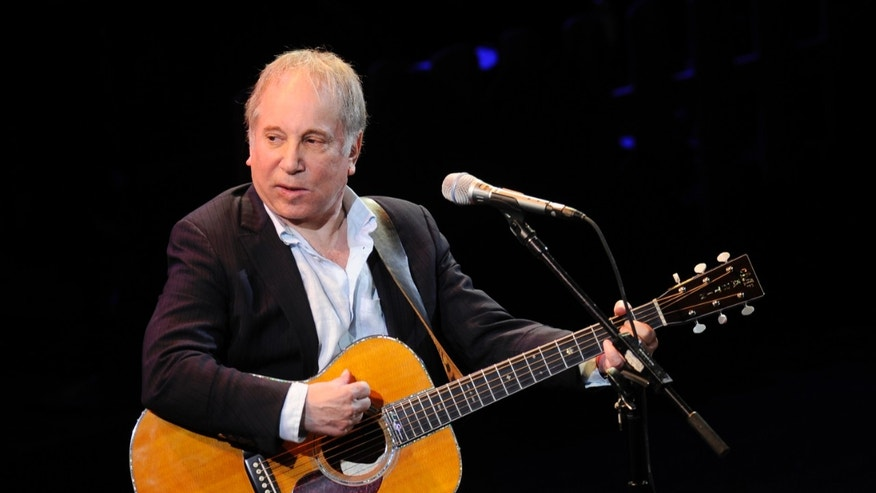 """This April 2, 2012 file photo shows singer Paul Simon performing at """"A Celebration of Paul Newman's Dream"""" in New York. Police in Connecticut say Paul Simon and his wife, singer Edie Brickell, have been arrested on disorderly conduct charges."""
