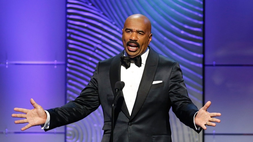 "TV host Steve Harvey presents the outstanding morning program award during the 40th annual Daytime Emmy Awards in Beverly Hills, California June 16, 2013. Harvey hosts ""Family Feud."""