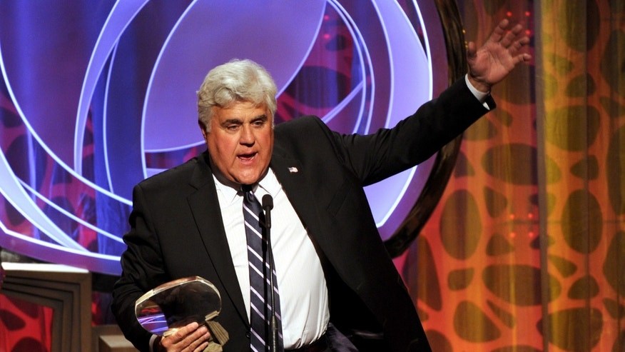 In this Tuesday, March 11, 2014 photo, Hall of Fame inductee Jay Leno speaks on stage at the 2014 Television Academy Hall of Fame at the Beverly Wilshire in Beverly Hills, Calif.
