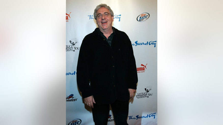 December 12, 2009. Actor and director Harold Ramis poses on the red carpet as he arrives for celebrations marking the 50th anniversary of improv theater, the Second City, in Chicago.