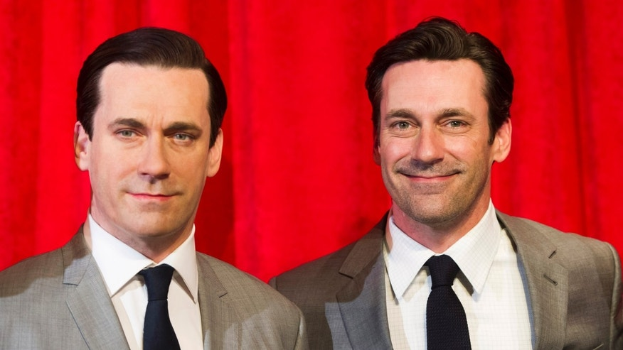 May 9, 2014. Jon Hamm, right, poses with his wax likeness at an unveiling at Madame Tussauds in New York.