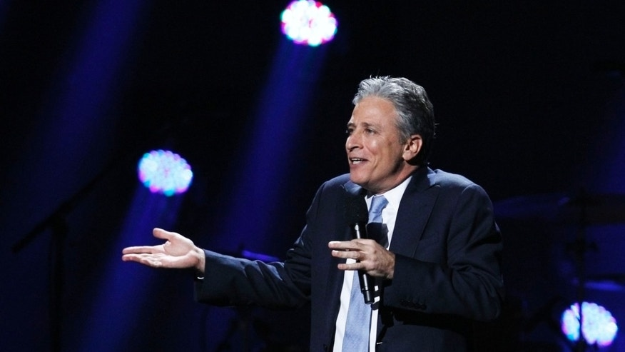 "December 12, 2012. Comedian Jon Stewart speaks during the ""12-12-12"" benefit concert for victims of Superstorm Sandy at Madison Square Garden in New York."
