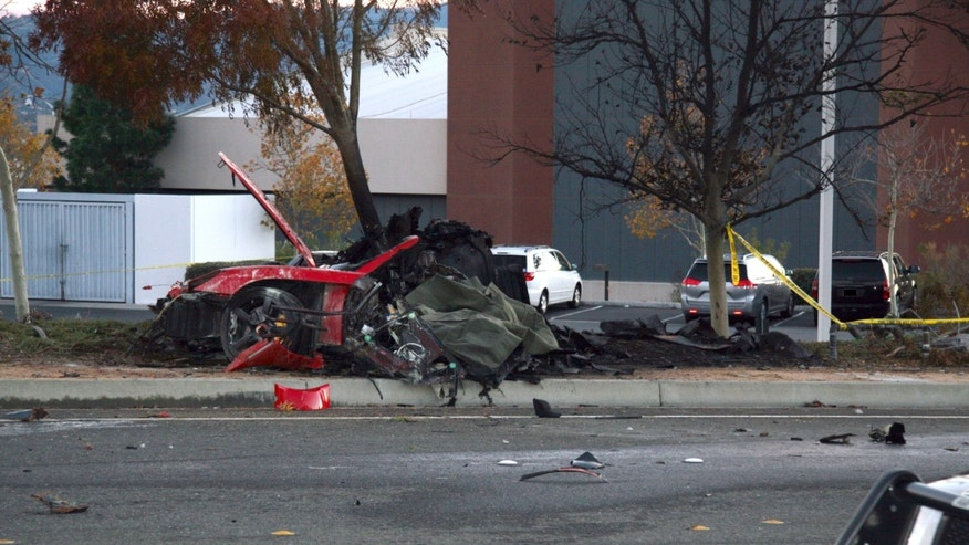 Nov. 30, 2013: The wreckage of a Porsche that crashed into a light pole in Valencia, Calif, killing Paul Walker and Roger Rodas.