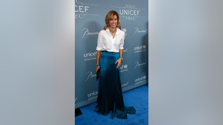 January 14, 2014. Actress Tea Leoni poses at the UNICEF Ball fundraising gala in Beverly Hills.