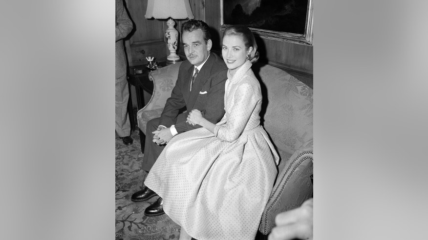 Jan. 5, 1956. Actress Grace Kelly and Prince Rainier III of Monaco, sit arm-in-arm as they meet the press in Philadelphia, Pa, USA. Grace Kelly can bring to mind several things: an Oscar-winning Hollywood actress, a mother, a princess and a Nicole Kidman movie premiering at the Cannes Film Festival on Wednesday, May 14, 2014.