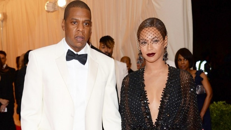 "May 5, 2014: This file photo shows Jay Z, left, and Beyonce at The Metropolitan Museum of Art's Costume Institute benefit gala celebrating ""Charles James: Beyond Fashion"" in New York."