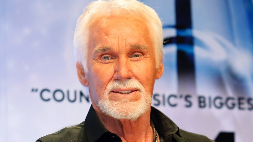 November 6, 2013. Kenny Rogers poses backstage after accepting the Willie Nelson Lifetime Achievement award at the 47th Country Music Association Awards in Nashville, Tennessee.