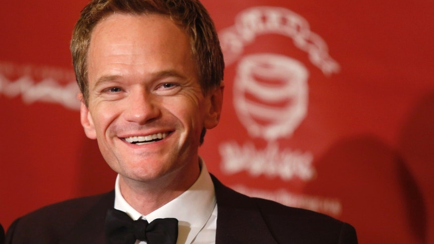 "February 7, 2014. Actor Neil Patrick Harris meets the media after he was honored as Hasty Pudding Theatricals ""Man of the Year"" during a roast at Harvard University in Cambridge, Massachusetts."
