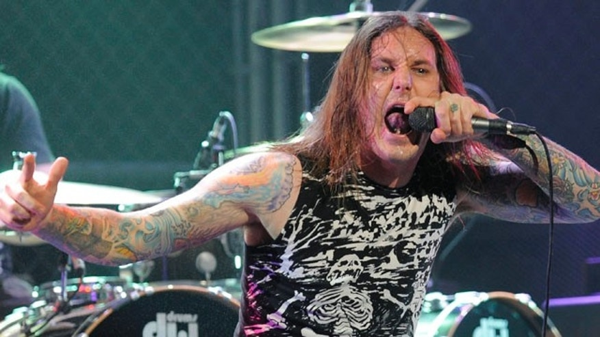 FILE:  Tim Lambesis of As I Lay Dying performs at the second annual Revolver Golden Gods Awards in Los Angeles.