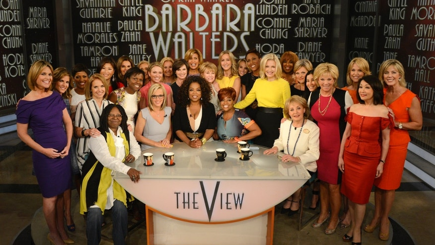 "May 15, 2014. Seated from left, Whoopi Goldberg, Jenny McCarthy, Oprah Winfrey, Sherri Shepherd and Barbara Walters posing with female broadcasters during a taping of Walters' final co-host appearance on ""The View,"" in New York."