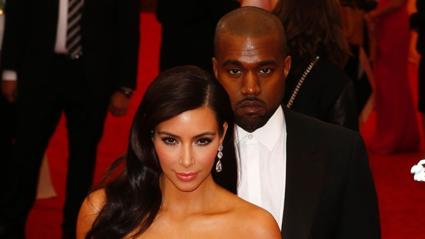 May 5, 2014. Kim Kardashian and Kanye West arrive at the Metropolitan Museum of Art Costume Institute Gala Benefit in New York.