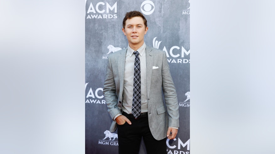 April 6, 2014. Country music singer Scotty McCreery arrives at the 49th Annual Academy of Country Music Awards in Las Vegas, Nevada.