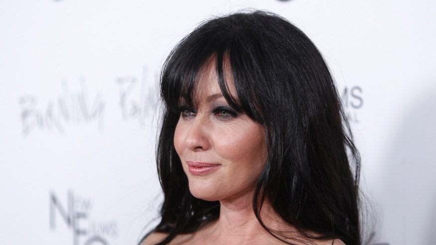"Shannen Doherty poses at the premiere of the film ""Burning Palms."""