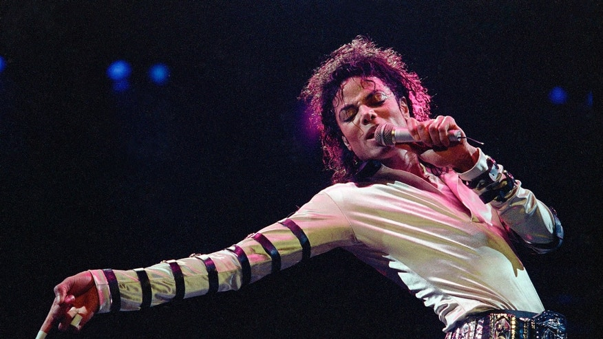 Feb. 24, 1988. Michael Jackson leans, points and sings, dances and struts during the opening performance of his 13-city U.S. tour, in Kansas City, Mo.