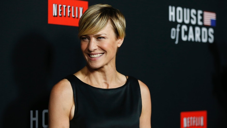 "Cast member Robin Wright poses at the premiere for the second season of the television series ""House of Cards""; at the Directors Guild of America in Los Angeles, California."