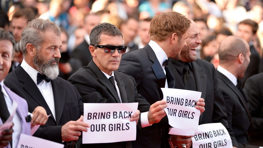 """CANNES, FRANCE - MAY 18:  (L-R) Actors Mel Gibson, Antonio Banderas and Kellan Lutz attend """"The Expendables 3"""" premiere during the 67th Annual Cannes Film Festival on May 18, 2014 in Cannes, France.  (Photo by Ian Gavan/Getty Images)"""