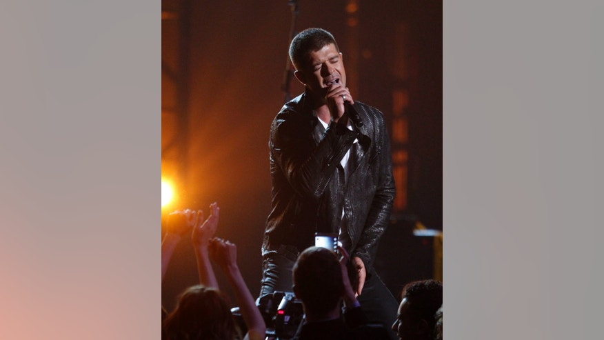 "May 18, 2014. Singer Robin Thicke performs ""Get Her Back"" at the 2014 Billboard Music Awards in Las Vegas, Nevada."