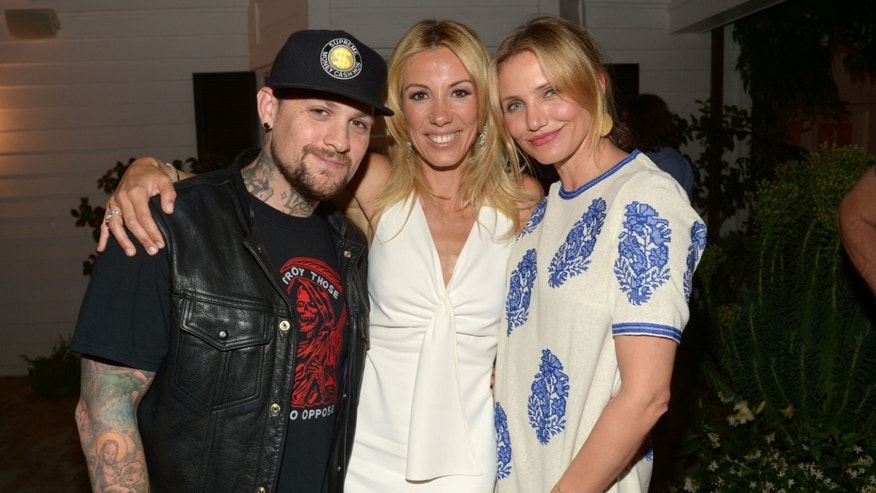 LOS ANGELES, CA - MAY 15:  (L-R) Musician Benji Madden, author Vicky Vlachonis, and actress Cameron Diaz celebrate the launch of The Body Doesn't Lie by Vicky Vlachonis on May 15, 2014 in Los Angeles, California.  (Photo by Jason Kempin/Getty Images for Goop)