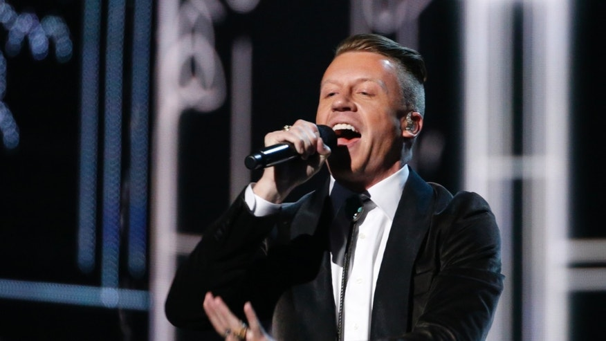 "January 26, 2014. Macklemore performs ""Same Love"" at the 56th annual Grammy Awards in Los Angeles, California."