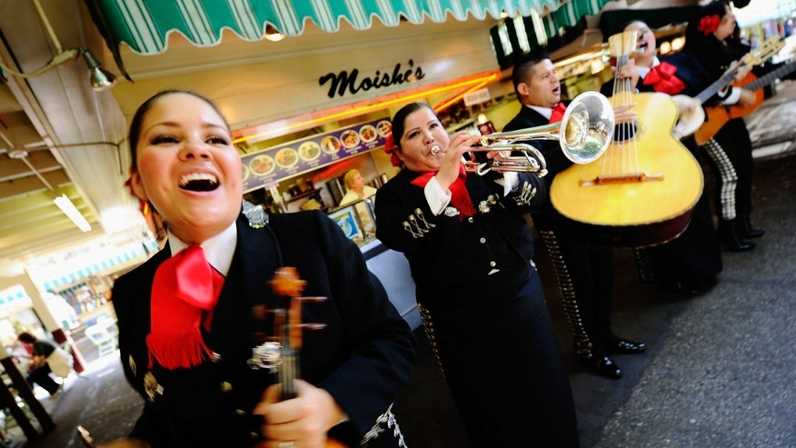 LOS ANGELES, CA - MAY 05:  Judith Merillo (L) Esmeralda Garcia (2nd-L) Guillermo Nunez (C) Mariana Nanez and Ileana Garcia (R)  members of the all-female strolling Mariachi band, Ellas Son, perform at Los Angeles Farmer Market during Cinco de Mayo festivities on May 5, 2011 in Los Angeles, California. Nunez was filling for the recovering injured female base player who was shot in the arm at a Mexican restaurant two weeks ago. Cinco de Mayo celebrates the 1862 Mexican victory over the French in the Battle of Puebla.  (Photo by Kevork Djansezian/Getty Images)