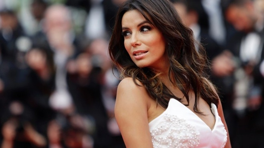 Actress Eva Longoria poses for photographers as she arrives for the screening of Saint-Laurent at the 67th international film festival, Cannes, southern France, Saturday, May 17, 2014. (AP Photo/Thibault Camus)