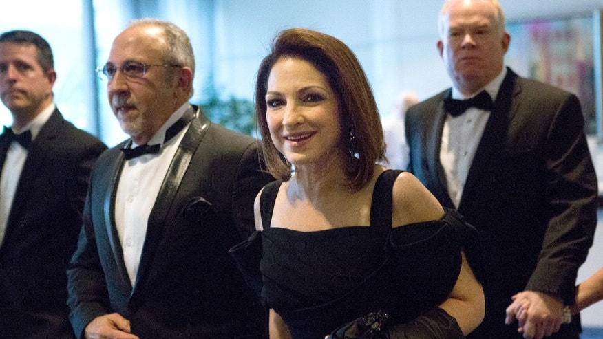 The Estefans arrive at the White House Correspondents' Association Dinner on May 3, 2014.