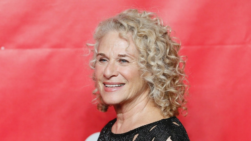 January 24, 2014. Singer Carole King poses at the 2014 MusiCares Person of the Year gala in her honor in Los Angeles.