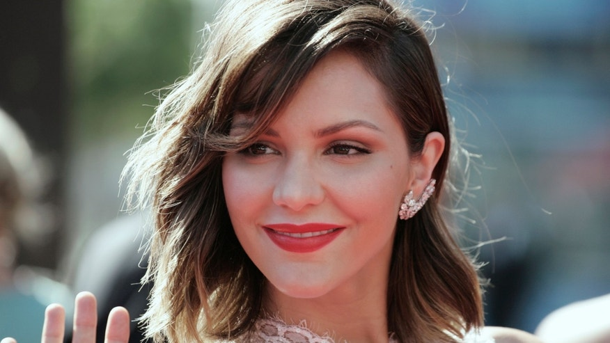 Singer and actress Katherine McPhee arrives at the 65th Primetime Creative Arts Emmy Awards in Los Angeles, California September 15, 2013.