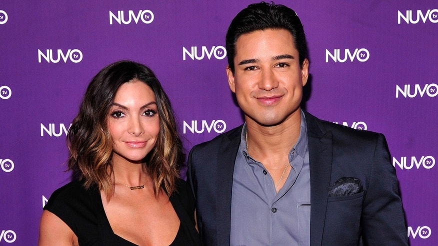 NEW YORK, NY - MAY 12:  Courtney Lopez (L) and Mario Lopez attend NUVOtv's 2014-2015 upfront at The Edison Ballroom on May 12, 2014 in New York City.  (Photo by Stephen Lovekin/Getty Images for NUVOtv)